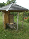 This was one of a kind...a six-sided hive, under protection of this lean-to.